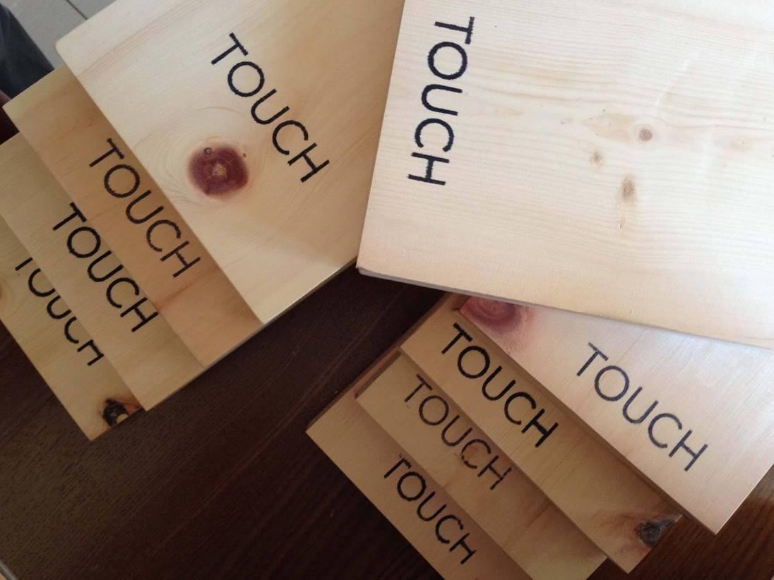 PREMIO MARCO BASTIANELLI 2017 OPERA AUTOPRODOTTA a Piero Cavagna e Giulio Malfer con il libro TOUCH. Un progetto costituito da un libro e una serie di schede interattive entrambi custoditi all'interno di una scatola di legno profumato. Le immagini dei ragazzi vittime dell'olocausto sono nascoste da una serie di spazi completamente neri che invitano ad essere toccati con un tocco energico. Touch, toccare con le dita, è un ponte che mette in comunicazione persone e storie mediando tra la forma tradizionale del libro e l'interattività dei dispositivi mobili che i ragazzi tengono in mano quotidianamente. Come la luce che viaggia fino a noi nel buio siderale i volti dei ragazzi vittime dell' olocausto affiorano dal buio sotto le nostre dita e ci illuminano chiedendoci attraverso il ricordo di prenderci cura di loro, di far uscire i loro volti dall'oblio. Il progetto è stato realizzato da Piero Cavagna e Giulio Malfer in collaborazione con i ragazzi di tre istituti scolastici della regione Trentino-Alto Adige /Südtirol. Un progetto impegnativo e coinvolgente, completo ed innovativo nella fotografia, nella grafica come nel contenuto del testo.